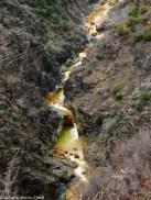 Yellow river below the prison and mine | Një lum i bardhë poshtë minierës dhe burgut