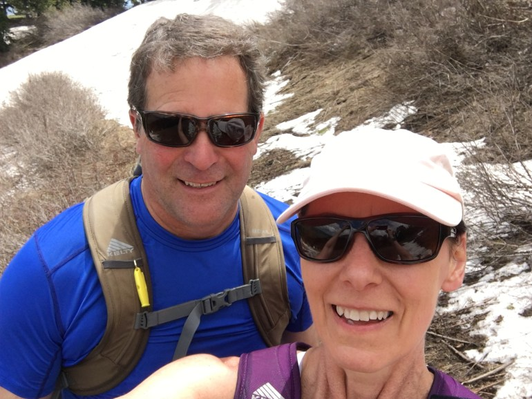 A selfie of my husband and me in snow at the top of Ben Lomond, Ogden, Utah