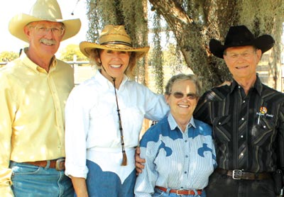 Dean Van Camp, left, and Sandra Wise, second from left, introduce special folks—young and old, burdened, weary or worried—to a special breed of native horses born and raised on the 4,700 acre ranch of 2010 Central Florida Humanitarians, Bill and Margaret Broussard, at right. (SpaceCoastDaily.com image)