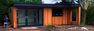 7m Wide Cedar Cladded Garden Room with bed, toilet and shower.