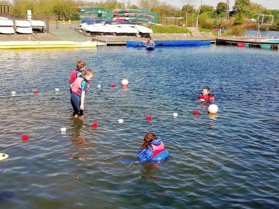 children learning to float in water