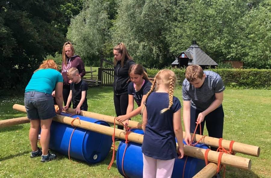 children constructing a raft