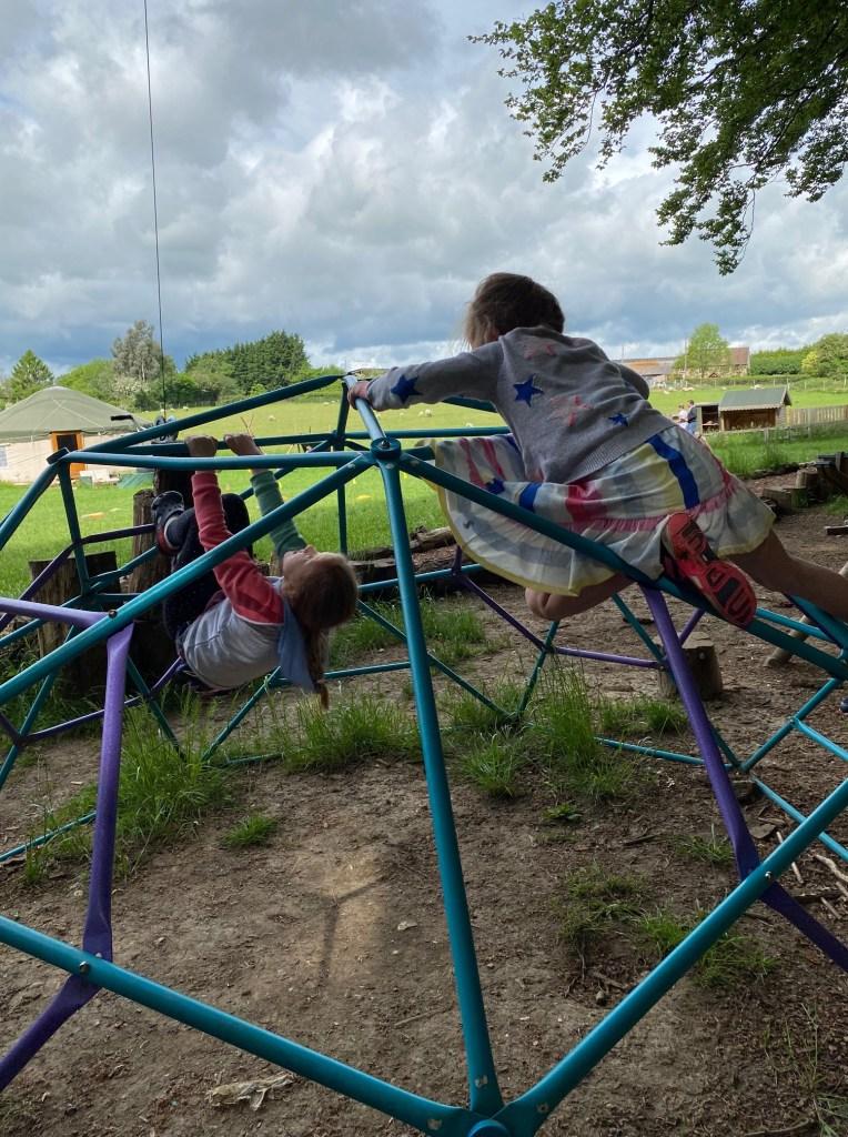 Children clambering on an hexagonal climbing frame