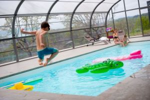 The covered pool at la Ferme du Cayla means that families can swim and play whatever the weather in France