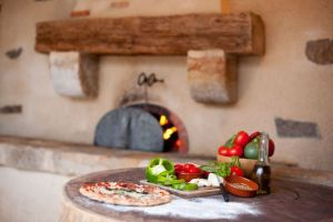 Making kids happy on a luxury family holiday: La Ferme du Cayla have a pizza night with freshly made pizzas from their wood-burning oven