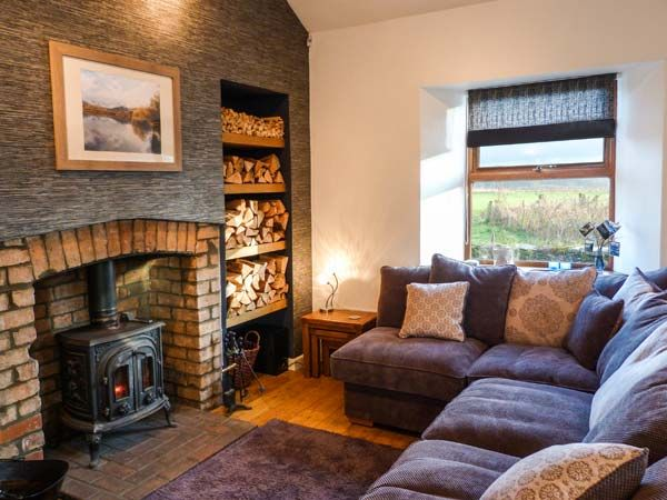 cosy living room with log burner couch ideas for small 10 cottages open fires space in your case the perfect place to curl up front of a fire on edge