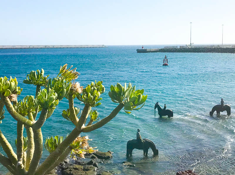 Sculptured horses in the sea at the Museo de Arte Contemporaneo in Lanzarote present a stunning view over the docks of Arrecife