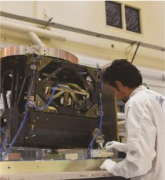 A Ball Aerospace technician works on a Geostationary Environment Monitoring Spectrometer. Credit: Ball Aerospace