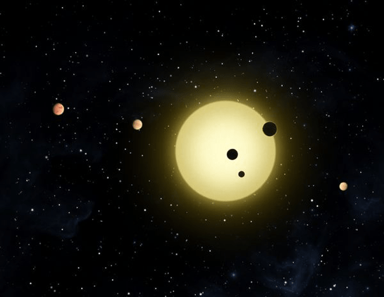 An artist's representation of Kepler-11, a small, cool star around which six planets orbit. Credit: NASA/Tim Pyle
