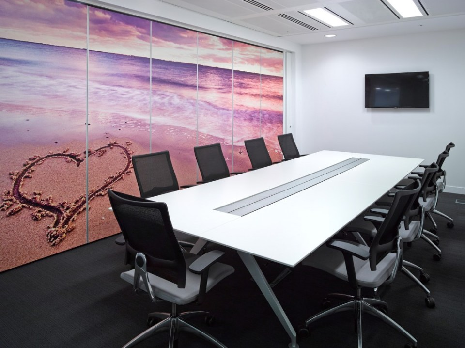 Image of Thomas Cook HQ meeting room with digital wall graphics