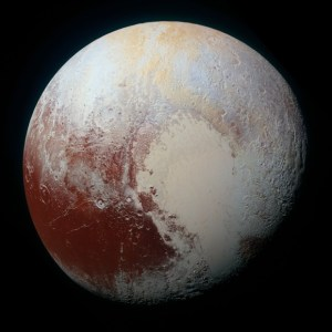 A high-resolution enhanced color view of Pluto combining the blue, red and infrared images taken by a Multispectral Visual Imaging Camera. Pluto's surface sports a remarkable range of subtle colors, enhanced in this view to a rainbow of pale blues, yellows, oranges, and deep reds.