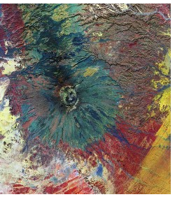 Aerial view of Emi Koussi, a shield volcano in the central Sahara desert, with contrasting mineralogy depicted in false colour. The cone of the volcano is green, while the surrounding area is reds and yellows.