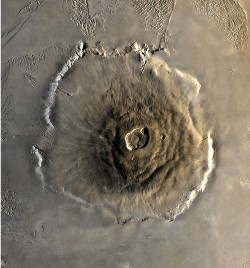 Arial view of Olympus Mons crater, showing its grey/brown summit