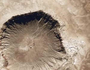Aerial view of Barringer Crater, a well-preserved sandy impact crater in the USA with steep and dark edges.