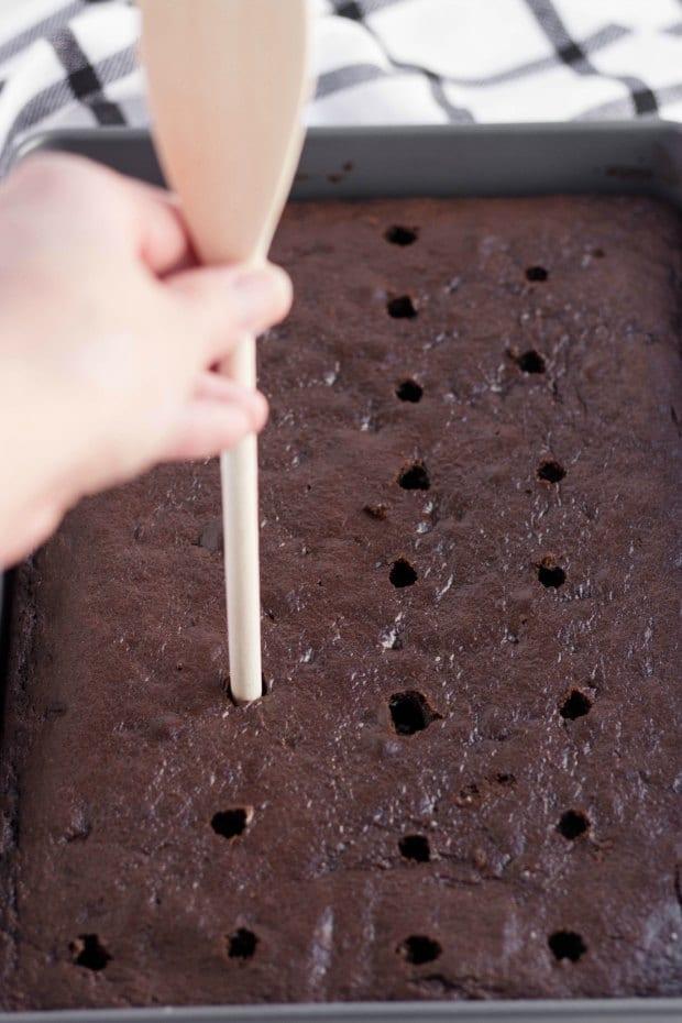 Using spoon to make a poke cake