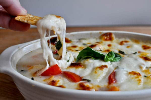 No guest will be able to resist this melty hot caprese dip.