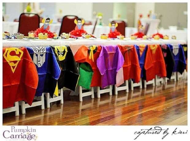 superhero themed birthday party table setting capes