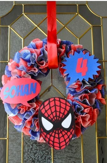 This fun Spiderman Cupcake Liner Wreath is festive and easy to make.