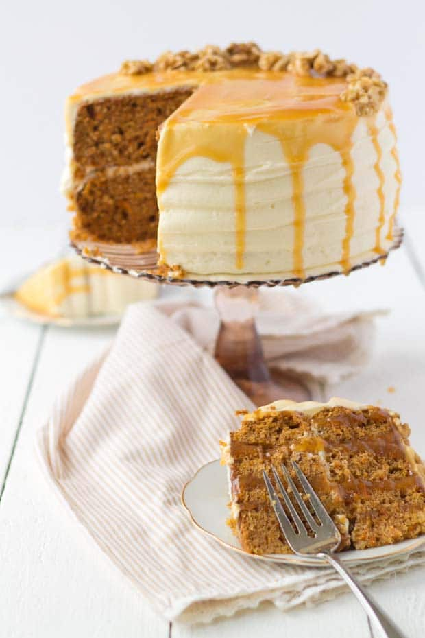 carrot cake with one slice cut on a plate