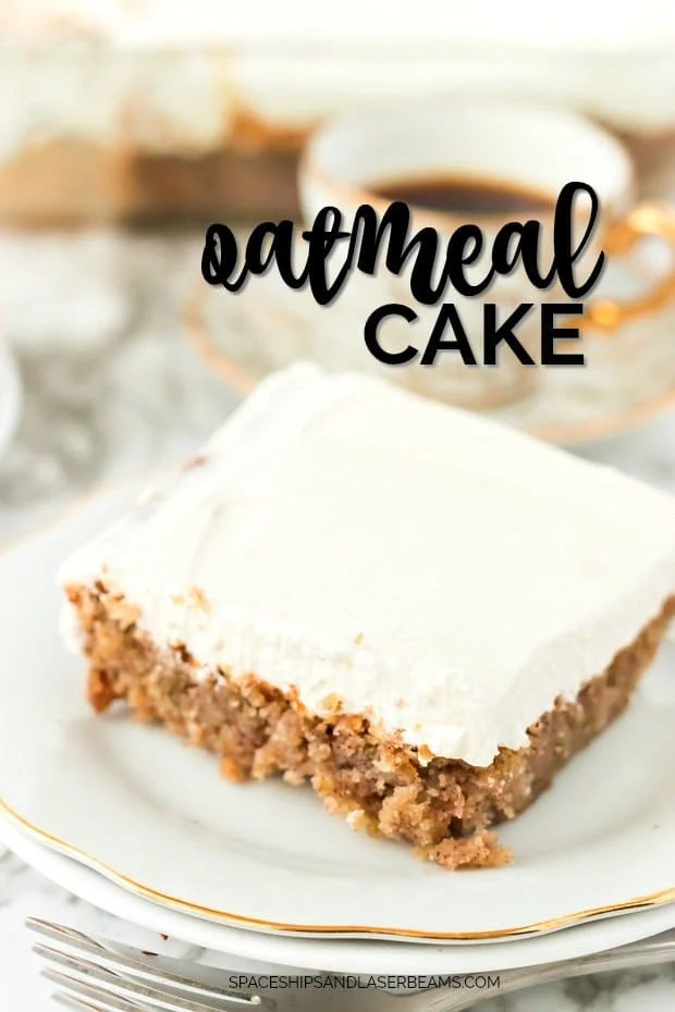 square slice of oatmeal cake with white frosting on a white plate