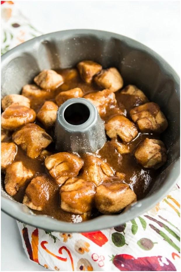 cinnamon rolls and sauce in bundt pan