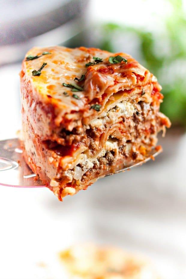 slice of lasagna being served