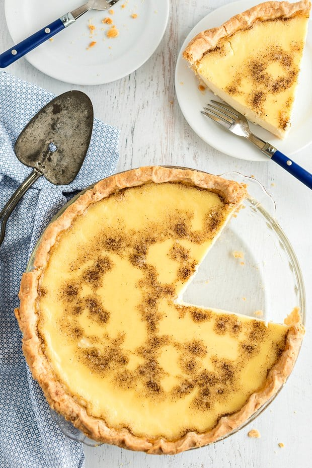 custard pie with one slice removed