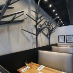 The black trees that perch above the booths.