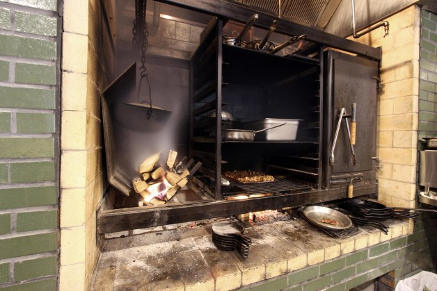 The custom-fabricated hearth with three cooking compartments.