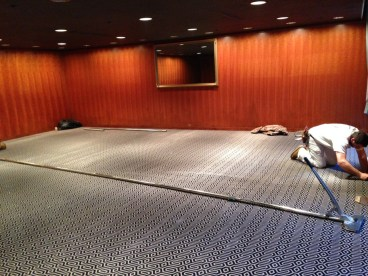 Carpet being laid in the private Cherry Room after the ceiling was painted a rich brown.