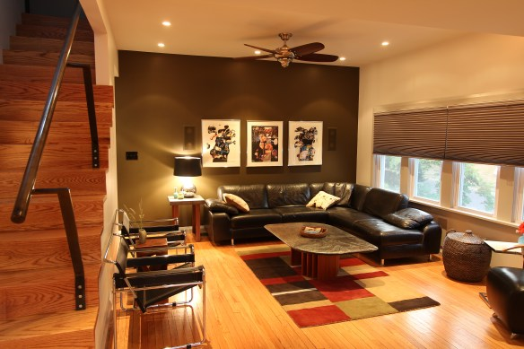 The living room. The bronze wall visually divides the house's private and public areas.