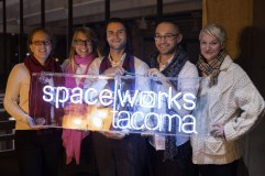 Kris Crews captured this luminous image of Spaceworks staff holding custom-made neon sign by local artist Galen Turner. Thanks to generous contributions from big organizations to small Tacoma businesses to individual donations, Spaceworks staff grew in 2016 to accommodate more clients and provide higher quality of services. Left to right: Gwen Kohl, Heather Joy, Gabriel Brown, Dmitry Mikheyev, & Kate Monthy.
