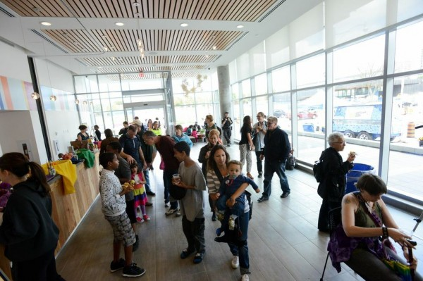 People gather inside at the Artscape Lounge at Daniels Spectrum. Image by Garrison McArthur Photographers.