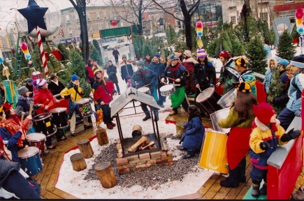 Winter revelers in Montreal gather at Parc Compagnons-de-St-Laurent for a bonfire, beer, and music. Image courtesy of Tourisme Montreal.