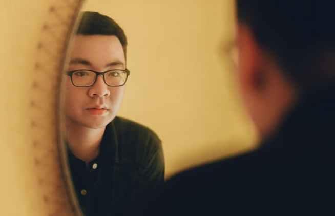 asian man looking in mirror-pexels-photo-1134184