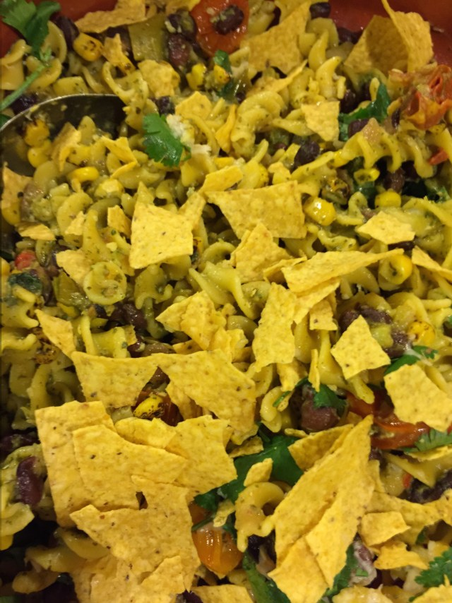 Corn rotelli with a garnish of crushed tortilla chips