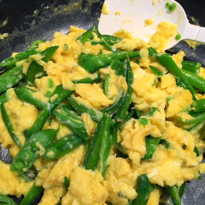 Scrambled eggs with goat cheese and spring peas