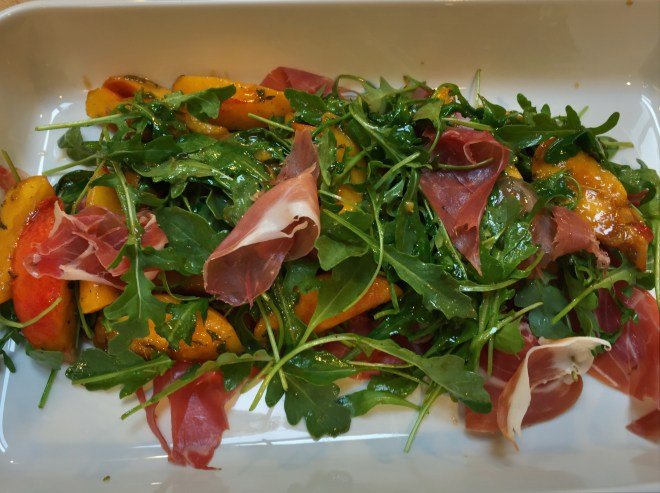 Warm peach salad with proscuitto and arugula