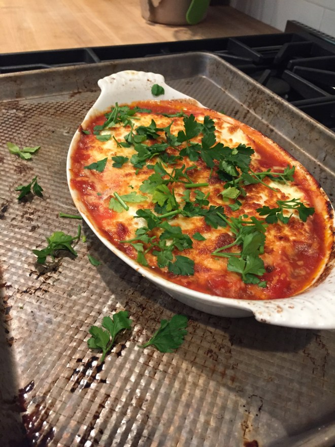 Baked Eggs in Tomato Sauce with Cheese