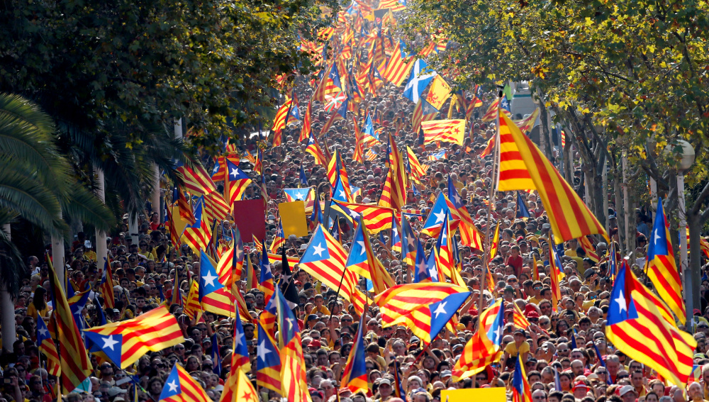 "People hold  Catalan separatist flags known as ""Esteladas"" during a gathering to mark the Calatalonia day ""Diada"" in central Barcelona"
