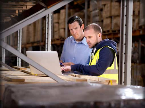 Commercial lines quote request photo showing business men reviewing paperwork in warehouse