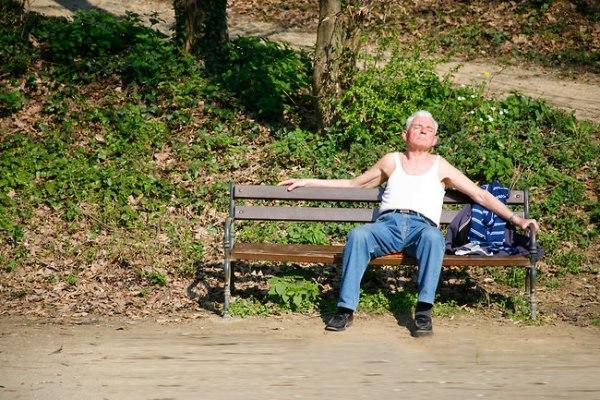 sunbathing old man