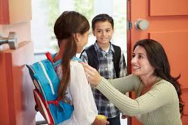mother prepares children for school
