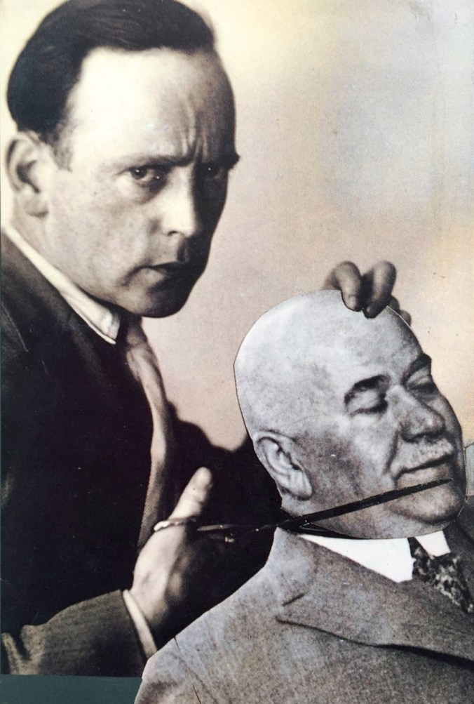 Photomontage by John Heartfield: the artist himself with a pair of scissors and paper