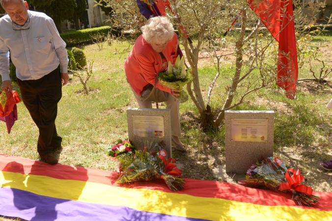 Mario Kloostra's cousin Corrie Triep (child of Arie Kloostra's sister) laying flowers at the memorial plaques after the unveiling of the memorial at the San Esteban de Letera cemetery, April 2015