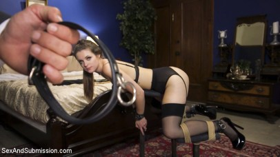 Nora Riley restrained at Sex and Submission