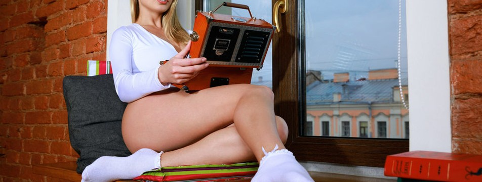Sexy glamour model Sarika A poses with an antique radio