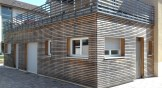 Verwitterte Fassadenverkleidung ohne Holzanstrich