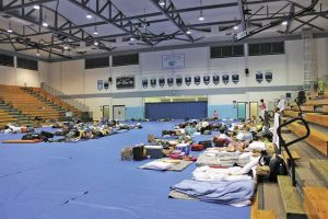 Nearly 200 Big Island residents and visitors took shelter at Kealakehe High School ahead of the anticipated arrival of Tropical Storm Iselle in 2014. (Chelsea Jensen/West Hawaii Today)
