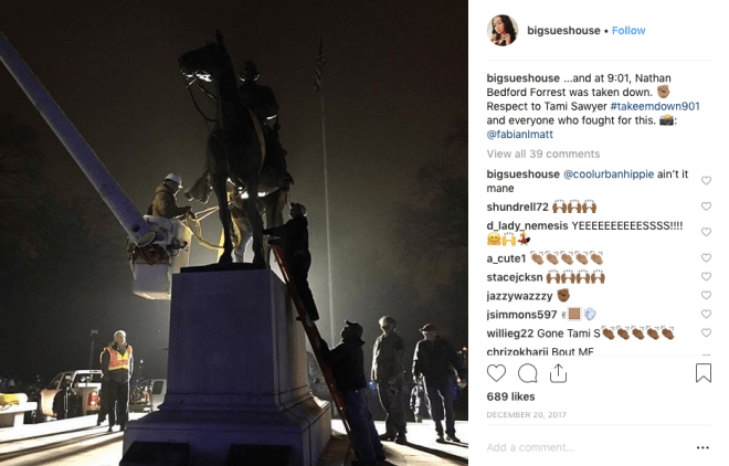 Image shows a construction crew working under scant lighting in order to remove the Forrest statue.